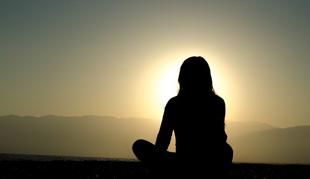 Woman meditating for wellness